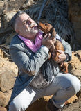 Attractive bearded man on the seashore with dachshund, dog Stock Images