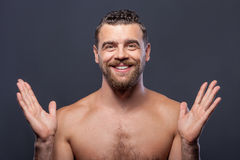 Attractive bearded naked guy is expressing Royalty Free Stock Image