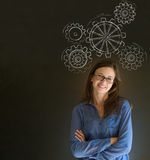 Woman thinking with turning gear cogs or gears Royalty Free Stock Photography