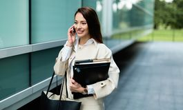Attractive and beautiful businesswoman walking and talking Royalty Free Stock Photos