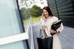 Attractive and beautiful businesswoman walking and talking Royalty Free Stock Photo