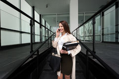 Attractive and beautiful businesswoman walking and talking Stock Photo