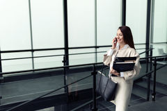 Attractive and beautiful businesswoman walking and talking Stock Photos