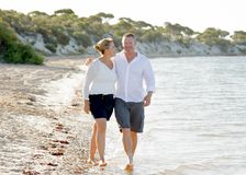Attractive beautiful  couple in love walking on the beach in romantic summer holidays Stock Images