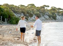 Attractive beautiful  couple in love walking on the beach in romantic summer holidays Royalty Free Stock Photos