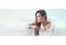 Attractive beautiful girl in bedroom Royalty Free Stock Photos