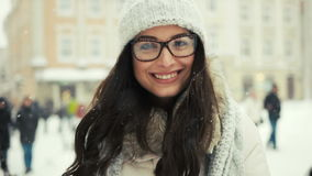 Attractive beautiful lady posing and flirting on camera over snowy city background stock video footage
