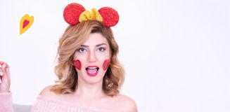 Attractive beautiful model woman in funny crown stock photo
