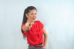 Attractive beautiful smiling successful businesswoman point ahea Stock Photo
