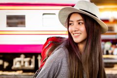 Attractive beautiful traveler woman love journey to several countries by alone. Charming beautiful young woman can see beautiful royalty free stock photography