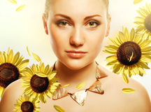 Attractive beautiful woman with accessorize. And helianthus Stock Photography
