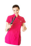 Attractive beautiful woman/beautician holding hair straightener, showing OK. stock photos