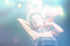 Attractive beautiful woman in dress with curly hair and lights. Attractive woman in dress with curly hair and lights royalty free stock photos