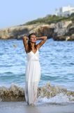 Attractive and beautiful woman enjoying vacation summer holidays at Spain coast village walking on beach. Young attractive and beautiful woman enjoying vacation Stock Image