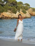 Attractive and beautiful woman enjoying vacation summer holidays at Spain coast village walking on beach. Young attractive and beautiful woman enjoying vacation Royalty Free Stock Images