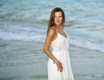 Attractive and beautiful woman enjoying vacation summer holidays at Spain coast village walking on beach Stock Photography