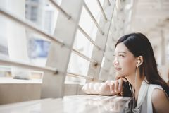 Attractive beautiful woman feels happy and relaxing. Beautiful g royalty free stock image
