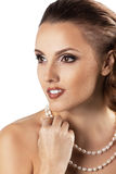 Attractive beautiful woman with pearls jewerly Stock Photos