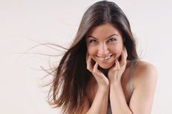 Attractive beautiful woman with pure skin and strong healthy bri. Ght hair on white background Stock Images