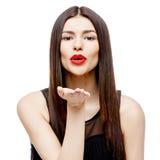 Attractive beautiful woman showing air kiss Stock Photos
