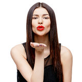 Attractive beautiful woman showing air kiss Royalty Free Stock Photography