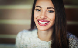 Attractive and beautiful woman smiling and posing to camera. Attractive and beautiful woman with divine smile posing to camera Royalty Free Stock Photo