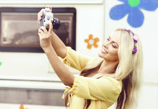 Attractive, beautiful, young girl taking pictures outdoors. Holi Royalty Free Stock Photography