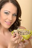 Attractive Beautiful Young Woman Holding a Bowl of Breakfast Cer Royalty Free Stock Photo