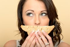Attractive Beautiful Young Woman Holding a Brown Bread sandwich Stock Photography