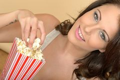 Attractive Beautiful Young Woman Portrait Eating Popcorn Royalty Free Stock Images
