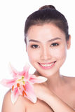 Attractive beauty asian female face with flower Royalty Free Stock Photography