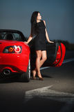 Attractive beauty sexy woman portrait with car Stock Photo