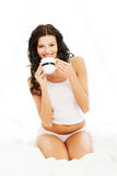 Attractive in bed with mug of something hot. Stock Photography
