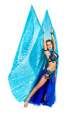 Attractive belly dancer dressed in a blue costume Royalty Free Stock Photo