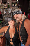 Attractive Biker Gang Couple. Attractive middle aged biker couple with bandannas in bar Stock Photography