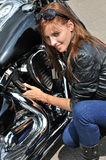 Attractive biker woman and her motorcycle. At the motorbike show Stock Image