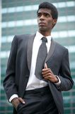 Attractive black businessman standing outdoors Royalty Free Stock Photography