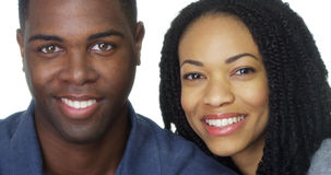 Attractive black couple smiling at camera Stock Images