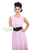 Attractive black hair model presenting a plate of candies Royalty Free Stock Photography