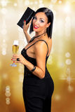 Attractive black hair woman holding glass of champagne Stock Image