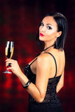 Attractive black hair woman holding glass of champagne Royalty Free Stock Photos