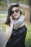 Attractive black haired woman using phone Royalty Free Stock Photo