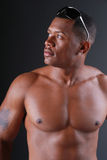Attractive Black man. Attractive Black man, with no shirt on and sunglasses on his head royalty free stock images