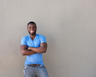 Attractive black man with beard smiling with arms crossed Stock Photography