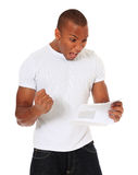 Attractive black man gets good news via mail Royalty Free Stock Photo
