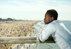Attractive black man relaxing at the beach. Portrait of an attractive black man relaxing at the beach Royalty Free Stock Photo