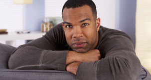 Attractive Black man resting on couch Royalty Free Stock Image