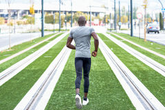 Attractive black man running in urban background Stock Image
