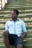 Attractive black man sitting on stairs outdoors Royalty Free Stock Photo