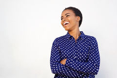 Attractive black woman laughing against white background Stock Photos